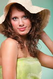 Beautiful spring woman portrait. Green concept. Beautiful smiling spring or summer woman in hat. Green concept Royalty Free Stock Images