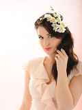 Beautiful spring woman with pure skin and flowers Stock Photography
