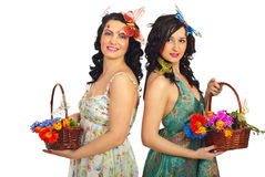 Beautiful spring women holding flowers Stock Photography
