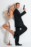 Beautiful spy couple in evening dress with a guns. Stock Photo
