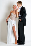 Beautiful spy couple in evening dress with a guns. Royalty Free Stock Photo