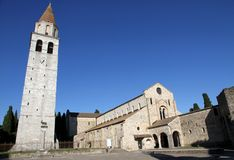 Beautiful square with church and high Bell Tower of ancient town Royalty Free Stock Photos
