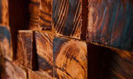 Stack of wooden square objects unique background photo. Beautiful square shape wooden objects with texture unique abstract background photo stock photos
