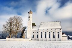 Beautiful St. Coloman pilgrimage church, Bavaria, Germany in snowy winter day stock photos