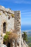 Beautiful St. Hilarion Castle in Northern Cyprus captured on a vertical photography. The historical building is overlooking the Mediterranean sea by the city royalty free stock photography