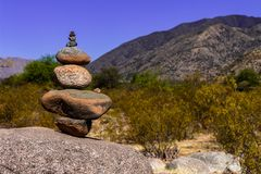 Beautiful stacking of rounded stones at the foot of the mountain. royalty free stock images