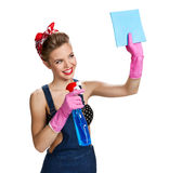 Beautiful staff wearing pink rubber protective gloves holding cleaning spray bottle and cellulose sponge Royalty Free Stock Photos