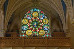 Beautiful Stain Glass Window at Saint Andrew`s Catholic Church. Roanoke, VA – May 25th: The view of a large stain round stain glass window over the organ stock image