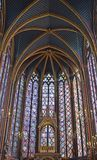 Beautiful stained glass windows in the upper level interior Sainte-Chapelle Paris France. Stained Glass windows at the upper level interior Sainte-Chapelle a Stock Photo