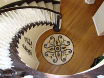 Beautiful Staircase with Mosaic Floor. Grand staircase leading upstairs, beautiful wood floors with a round tile mosaic inset stock image