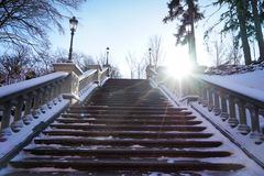 Beautiful stairs with banisters. In winter park royalty free stock images