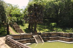 Beautiful stairway in water pool in ancient hinduist temple. Beautiful stairway in rock water pool in exotic rock ancient hinduist temple Royalty Free Stock Photography