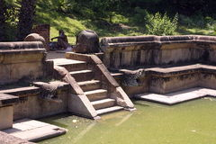 Beautiful stairway in water pool in ancient hinduist temple. Ruines of Beautiful  ancient old exotic  hinduist temple on sunny day in Sri Lanka Royalty Free Stock Photography