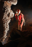 Beautiful stalactites in a cave. With a speleologist stock photography