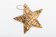 Beautiful star of birch bark. On white corrugated cardboard background. Ready for Christmas greeting stock illustration