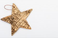 Beautiful star of birch bark. On white corrugated cardboard background. Ready for Christmas greeting vector illustration