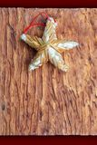 Beautiful star made of vegetable fibers. On wooden craftsman background. Ready for Christmas greeting stock photo