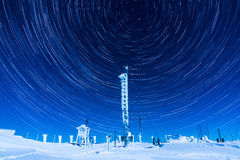 Beautiful Star Trails On The Night Sky During A Clear Winter Night While Spending Time On Top Of A Mountain Stock Photos