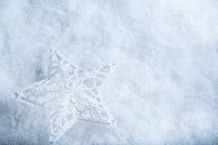 Beautiful star on a white frost snow background. Winter and Christmas concept. Instagram filter Stock Photography