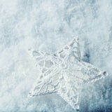Beautiful star on a white frost snow background. Winter and Christmas concept. Instagram filter Stock Image