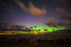 Beautiful starry night sky with aurora borealis. Aurora borealis on a beautiful sky in summer stock photos