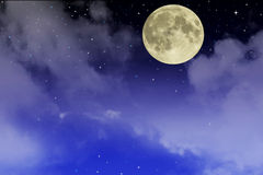 Beautiful starry sky with fool moon and clouds. Stock Photos