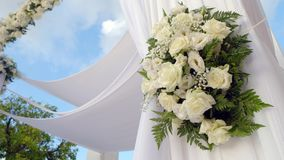 Beautiful static video 4k of the Jewish Hupa .Closeup on a bouquet from roses. Beautiful static video 4k of the Jewish Hupa , wedding putdoor .Beautifully stock video