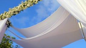 Beautiful static video 4k of the Jewish Hupa , wedding putdoor . Beautifully registered Huppa with a set of flowers stock footage