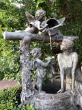 Beautiful statue with angels in the Park. View stock photography