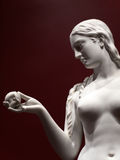 Beautiful statue of Eve with the apple Stock Photos
