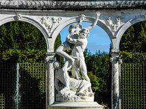 Beautiful statue of fight in garden in Paris on sunny day Stock Images
