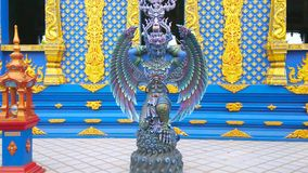 Garuda statue at Blue Temple, Chiang Rai, Thailand. The beautiful statue of Garuda bird-like creature, located at the side wall of Wat Rong Seua Ten Blue Temple stock video footage