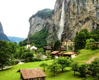Beautiful Staubbachfall waterfall flowing down the picturesque Lauterbrunnen valley and village in Bern canton, Switzerland, Europ Stock Photography
