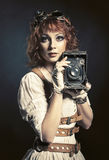 Beautiful steampunk girl with old camera Royalty Free Stock Image