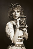 Beautiful steampunk girl with old camera. Old-fashioned. Stock Photo