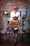 Beautiful steampunk woman back Stock Photo