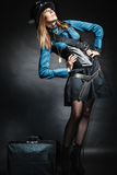 Beautiful steampunk woman with bag on black. Stock Photos