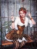Beautiful steampunk woman in the cage with gun Royalty Free Stock Photography