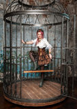 Beautiful steampunk woman in the cage Royalty Free Stock Photos