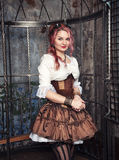 Beautiful steampunk woman in the cage Stock Images