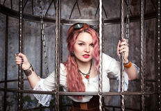 Beautiful steampunk woman in the cage Royalty Free Stock Image