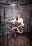 Beautiful steampunk woman in the cage Royalty Free Stock Photo