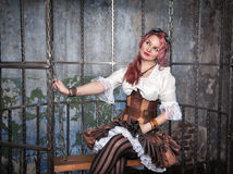 Beautiful steampunk woman in the cage Stock Photos