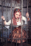 Beautiful steampunk woman in the cage Royalty Free Stock Photography