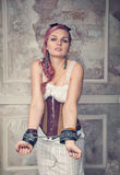 Beautiful steampunk woman with handcuffs Stock Images