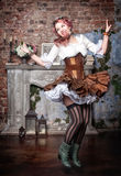 Beautiful steampunk woman jumping Royalty Free Stock Photography