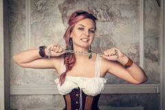 Beautiful steampunk woman with metal chain royalty free stock photo