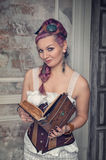 Beautiful steampunk woman with old book Royalty Free Stock Images