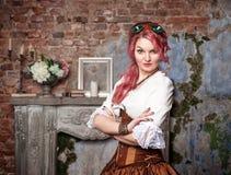 Beautiful steampunk woman posing Royalty Free Stock Image