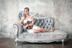 Beautiful steampunk woman on the sofa Stock Photo